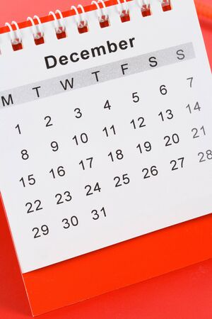 december kalender: Agenda december close up met rode achtergrond