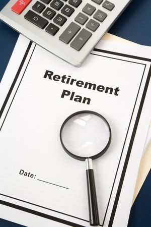 Retirement Plan and Magnifying Glass, business concept Stock Photo