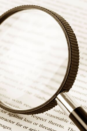 fine print: Magnifying Glass and document close up