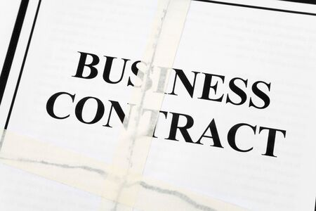 law breaking: Business Contract, Adhesive Tape and Torn paper