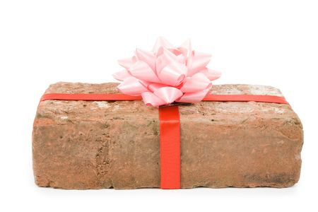 Red Brick Gift, Concept of joke, make fun of somebody, gift on April Fools Day, Prank gift photo