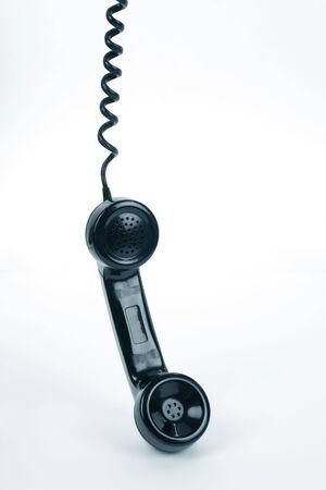 receiver: Black telephone Receiver close up shot Stock Photo