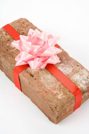 Red Brick Gift, Concept of joke, make fun of somebody, gift on April Fools Day, Prank gift