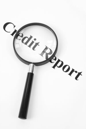 Credit Report and Magnifying Glass Banco de Imagens - 5200285