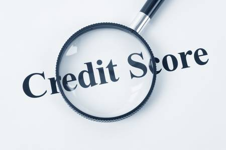 Credit Score and Magnifying Glass photo