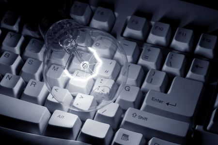 Light Bulb and Computer Keyboard close up shot