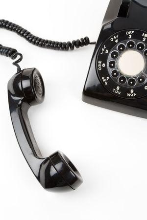 白い背景と黒の受話器