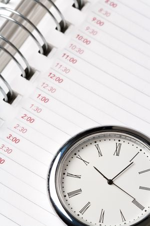 calendar and clock close up shot