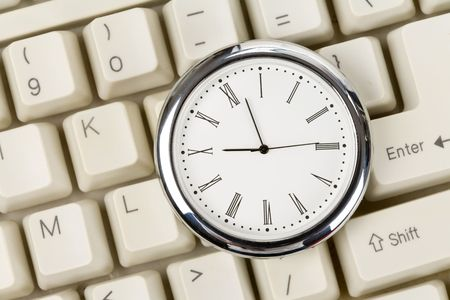 timely: Clock and computer Keyboard close up Stock Photo