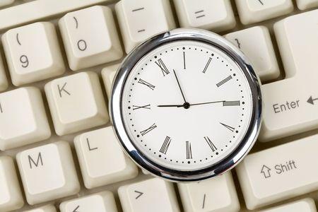 Clock and computer Keyboard close up Stock Photo
