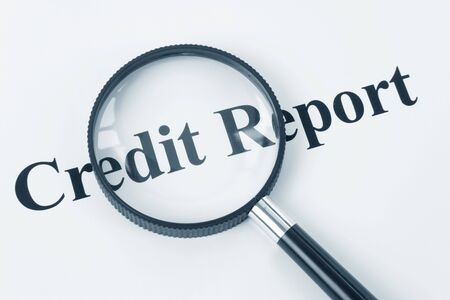 rated: Credit Report and Magnifying Glass