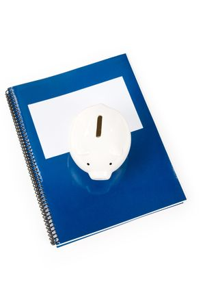 Blue school textbook and piggy bank,  education fund photo