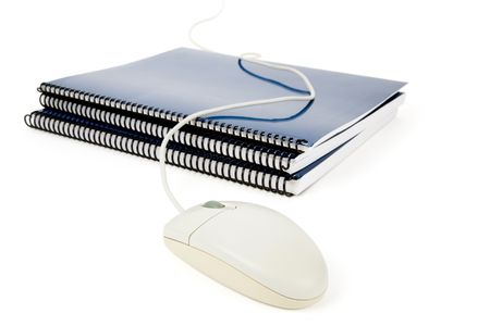 Blue school textbook and computer mouse, online learning Reklamní fotografie