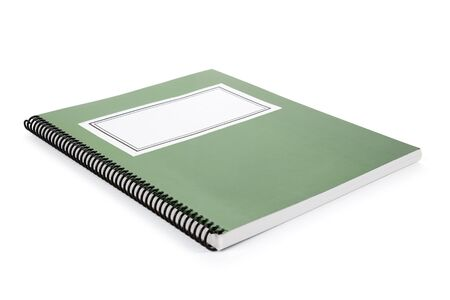 Green school textbook, notebook or manual with white background photo