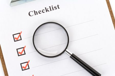 Checklist and magnifier close up photo