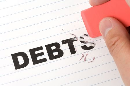 debt: eraser and word debt, concept of Reduce Debt Stock Photo