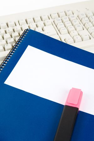 Blue school textbook and computer keyboard, online learning