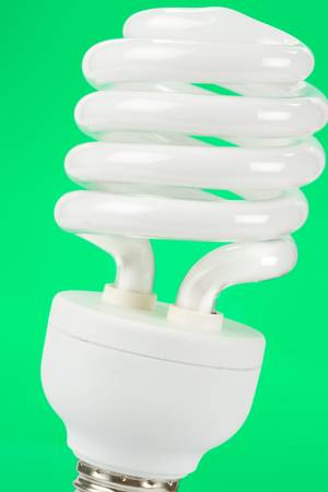 Compact Fluorescent Lightbulb with green background Zdjęcie Seryjne