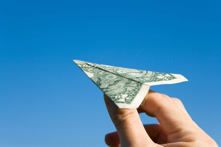 US Dollar Airplane and blue sky, concept of business success photo