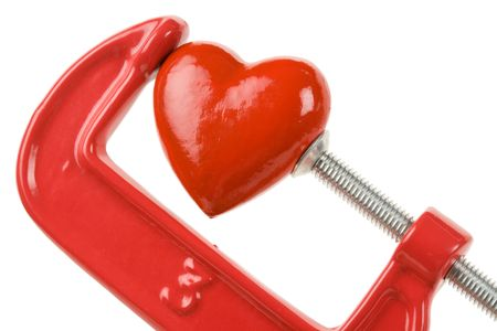 vise grip: Vise Grip and red heart, concept of stress, sadness, heart broken, Pain Stock Photo