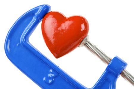 vise: Dise�ados Grip y el coraz�n rojo, el concepto de estr�s, la tristeza, el coraz�n roto, Pain Foto de archivo