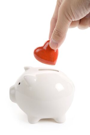 Piggy Bank and Red Heart, Concept of love, Charity and Relief Work photo