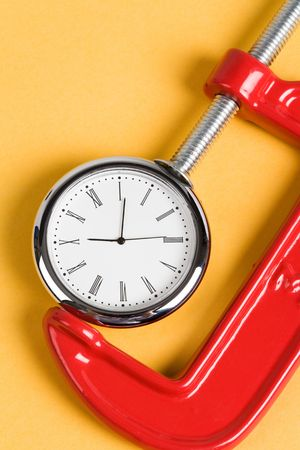 vise: Dise�ados Grip y reloj, concepto de ocupado Foto de archivo