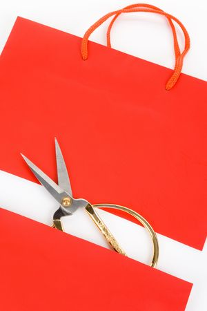Shopping Bag and scissor, concept of consumer confidence fall Banco de Imagens - 5809753