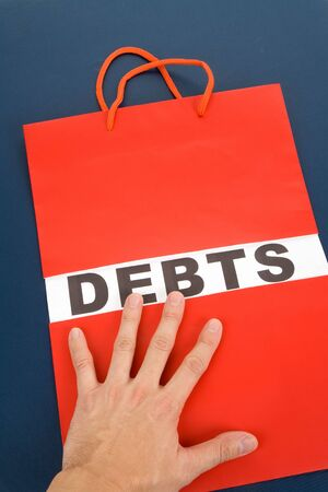 Shopping Bag and word debts concept of Financial difficulty Banco de Imagens - 5809756