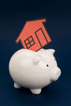 home sign and piggy bank , Real Estate Concept  photo