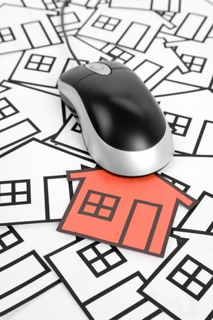 a red home sign and computer Mouse,  Real Estate Concept  Stock Photo - 6581621
