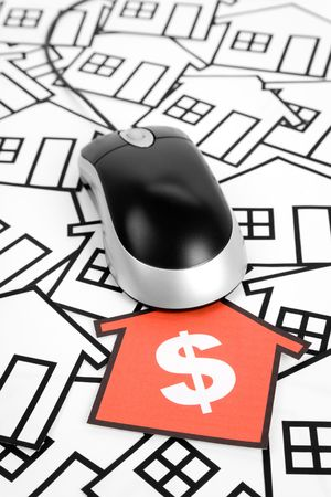 a red home sign and computer Mouse,  Real Estate Concept  photo