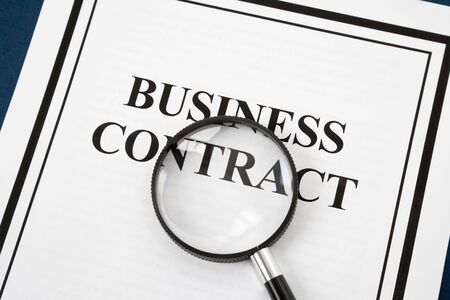 Business Contract and Magnifying Glass, business concept photo