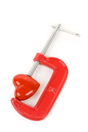 squeeze shape: Vise Grip and red heart, concept of stress, sadness, heart broken, Pain Stock Photo