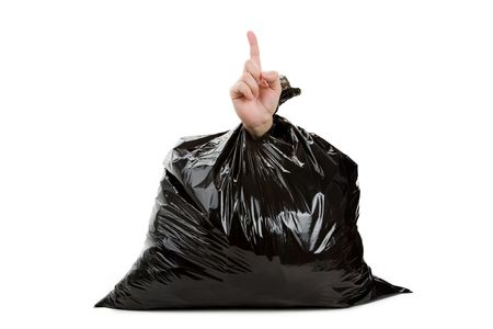 Black Garbage Bag and hand, concept of Loser