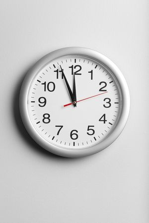 beat the clock: Clock on the wall Stock Photo