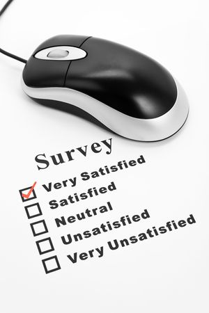 unsatisfied: Survey, questionnaire and computer mouse, business concept Stock Photo