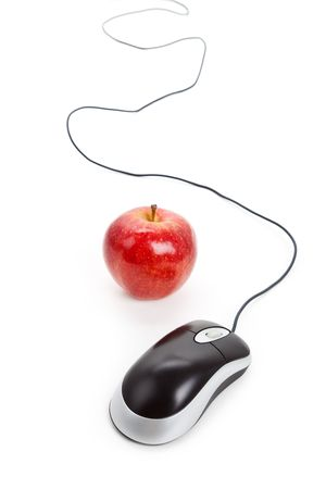 Computer Mouse and red apple close up photo