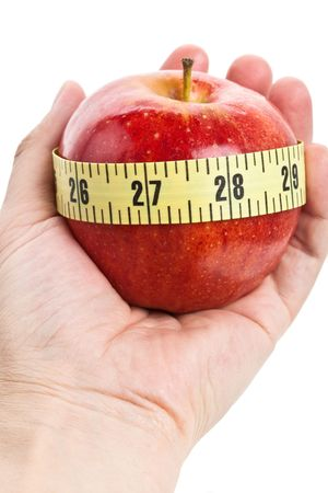 Red apple and Tape Measure close up Stock Photo