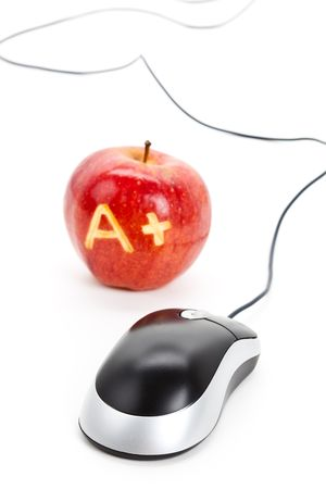 online: Red apple and A Plus sign,computer mouse, Concept of online learning