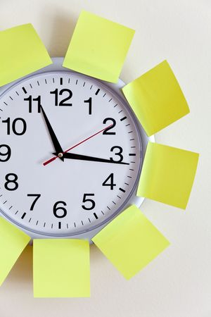 Clock and Adhesive Note close up Stock Photo