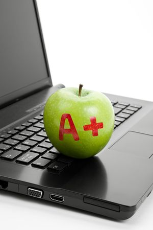 Green apple and laptop close up Stock Photo - 7071402