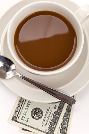 Coffee cup and dollar close up photo