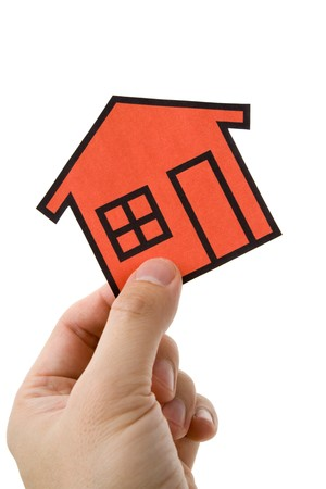 Hand holding a home sign, Real Estate Concept