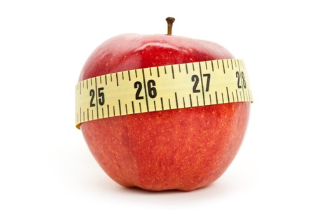 'tape measure': Red apple and Tape Measure close up Stock Photo
