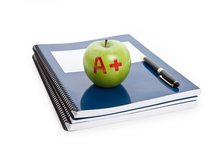Green apple and Textbook close up photo