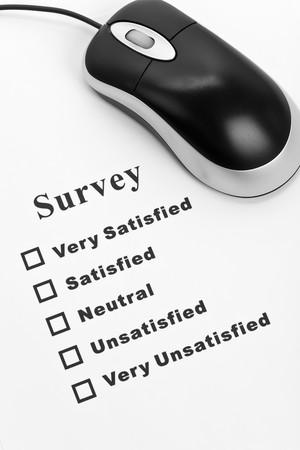 Survey, questionnaire and computer mouse, business concept Stock Photo