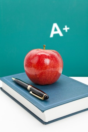 excellent: Red apple and Textbook close up