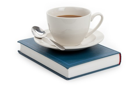 cup: Coffee cup and book with white background