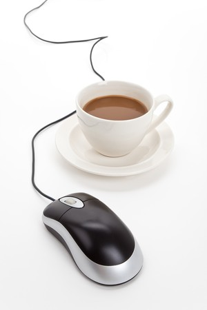 Coffee cup and computer mouse with white background Stok Fotoğraf